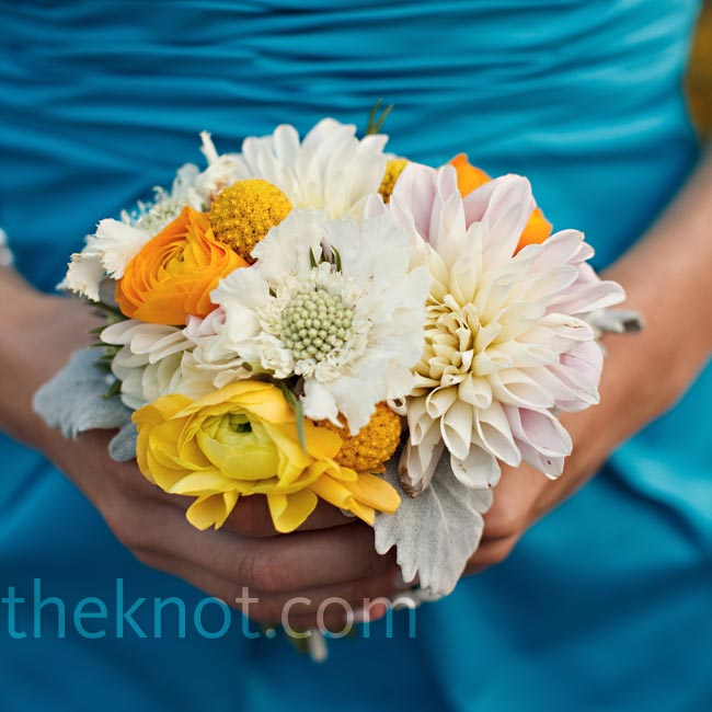 Identical but scaled-down versions of Elyse's bouquet were composed of both peach-yellow and soft pink ranunculus, white scabiosa blossoms, blush dahlias, and yellow craspedia.