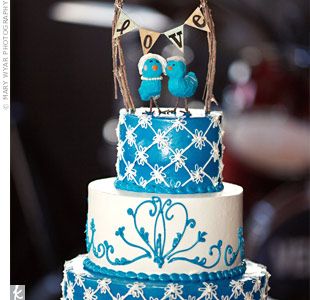 Quirky bird toppers provided the perfect vintage-looking accent to the patterned buttercream cake.