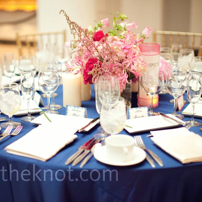 Low pink centerpieces popped against navy linens.