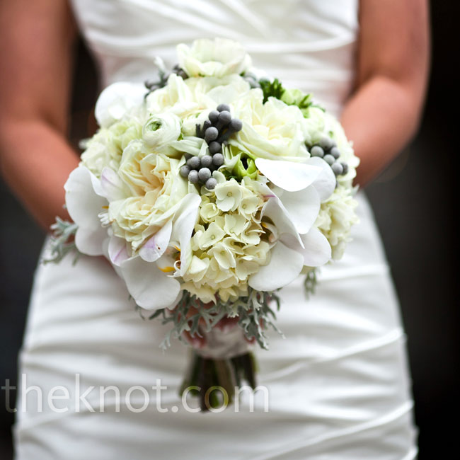 Silvery-gray brunia berries added subtle sophistication to Jamie's all-white bouquet.