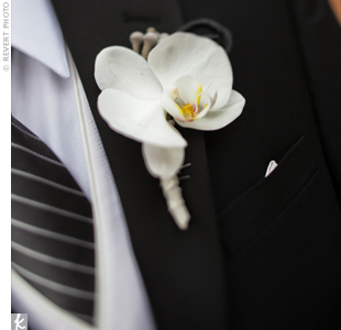 Alex's boutonniere was a white orchid wrapped in the same fabric that held Jamie's bouquet together.
