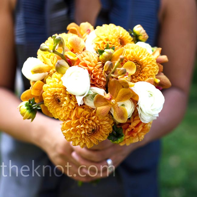 The bridesmaids carried lush orange bouquets made up of orchids, dahlias, and pops of white ranunculus.