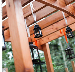 Small lanterns, hung by satin ribbons, gave the garden trellis a whimsical feel.