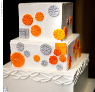 Sugar pinwheels were a whimsical addition to the three-tiered vanilla cake with buttercream frosting.