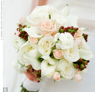 Katie's white and pink bouquet was accented with burgundy coffee berries and wrapped in her grandmother's handkerchief.