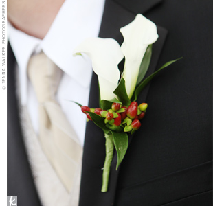 Rob's boutonniere contained white calla lilies with the same burgundy coffee berries that were in Katie's bouquet.