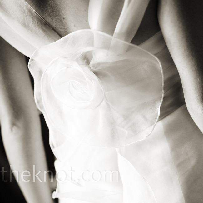 Elegant organza ruffling and a delicate flower detail on the back of Katie's gown added a fashionable surprise.