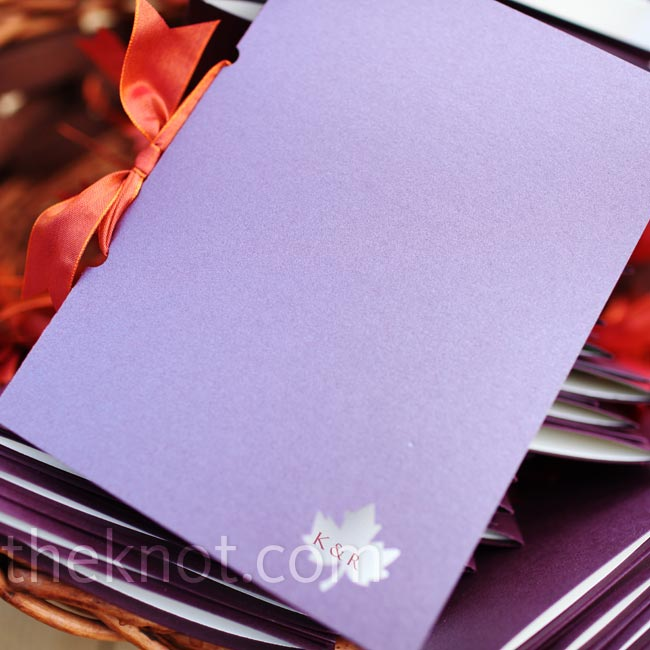 The couple presented guests with solid-colored purple programs tied together with a ribbon and marked with a tiny cutout leaf.