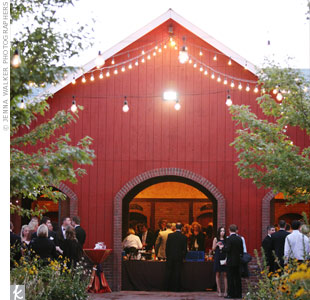 A barn with burnt-red planks and soaring ceilings set the scene for mingling and sipping cocktails.