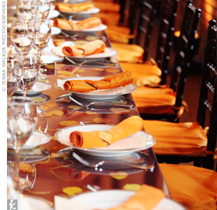The table linens were aubergine and pumpkin lamour. Twine-wrapped napkins added a rustic vibe.