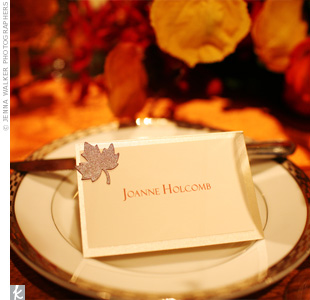 To keep with the fall theme, place cards were accented with metallic leaves.