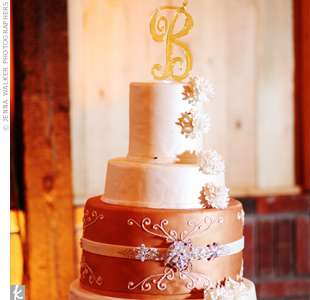 Made up of fondant icing and sugar flowers, the four-tiered cake was designed to match the colors Katie and Rob were wearing. A crystal band replicated Katie's belt.