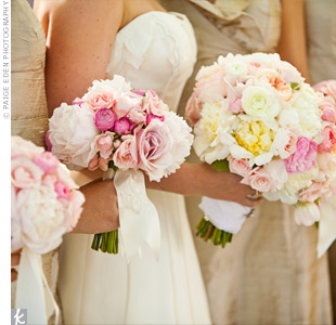 Silk ribbon, monogrammed with each bridesmaid's initials, was wrapped around their pink bouquets.