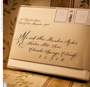 Each invitation box included champagne and ivory metallic stock cards and was marked with custom peony stamps.