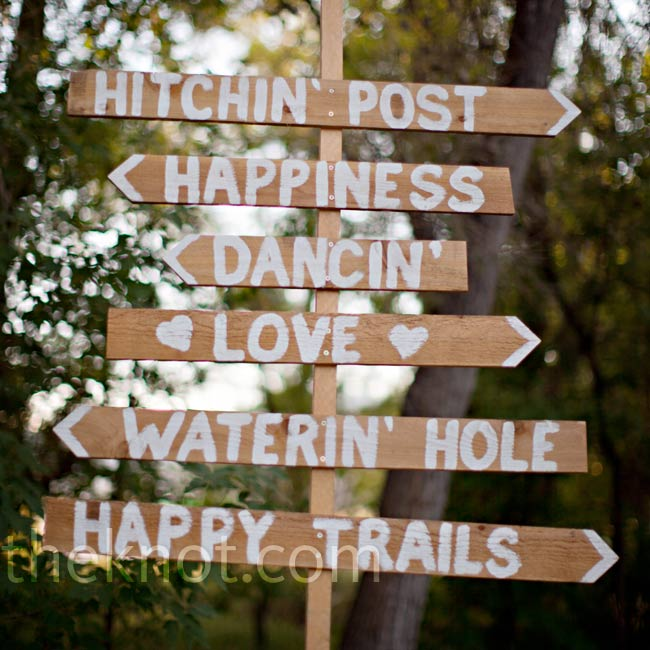 Hand-painted wooden signs were a warm way to direct guests as they arrived.