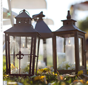Illuminated lanterns were placed along the aisle to create a romantic, dreamlike ambience.