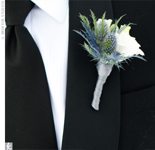 John's boutonniere included spiky blue thistle and white ranunculus.