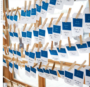 Stacy and John made their own escort cards and had them hung on a clothesline for guests to grab as they entered the reception.