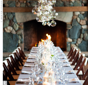 Tables covered in light-silver linens were topped with white napkins and votive candles, giving the barn a clean, modern look.