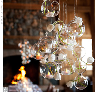 For a floating effect, the couple made chandeliers out of glass bulb vases filled with flowers and sparkling LED candles.