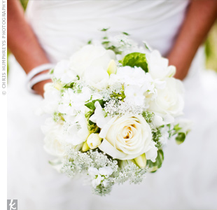 Bahie chose an all-white bouquet with roses to match the simple, classic look of her wedding style.