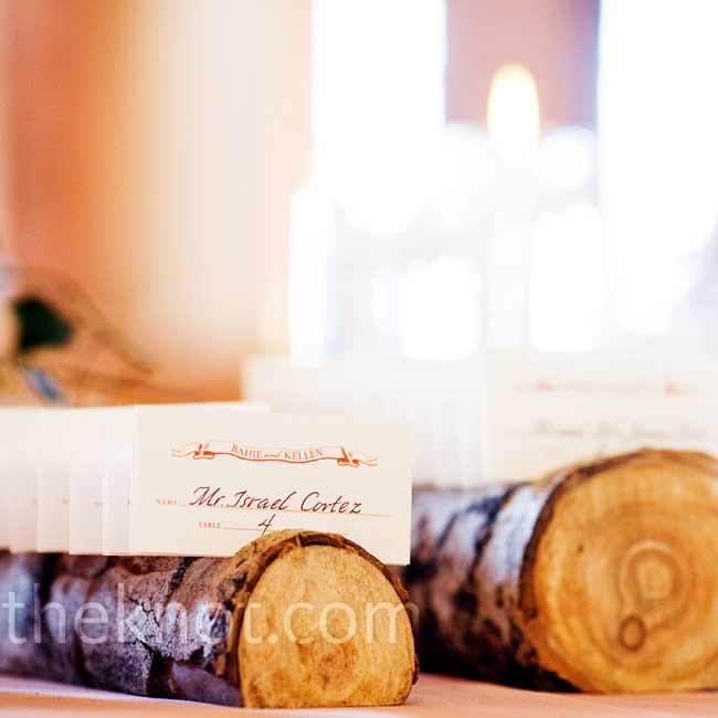 A calligrapher wrote guests' names on the escort cards, which were displayed on rows of aspen logs.