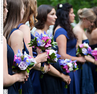 The bridesmaids chose their own dress styles in shades of indigo.