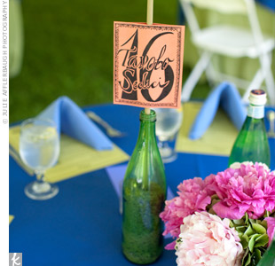 Table numbers, made by Jen, were attached to bamboo poles and placed in colorful glass bottles.