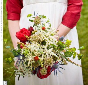Jill's bouquet featured large red blooms with accents of thistle, scabiosa pods, astilbes, wax flowers, and red clover for a wild look.