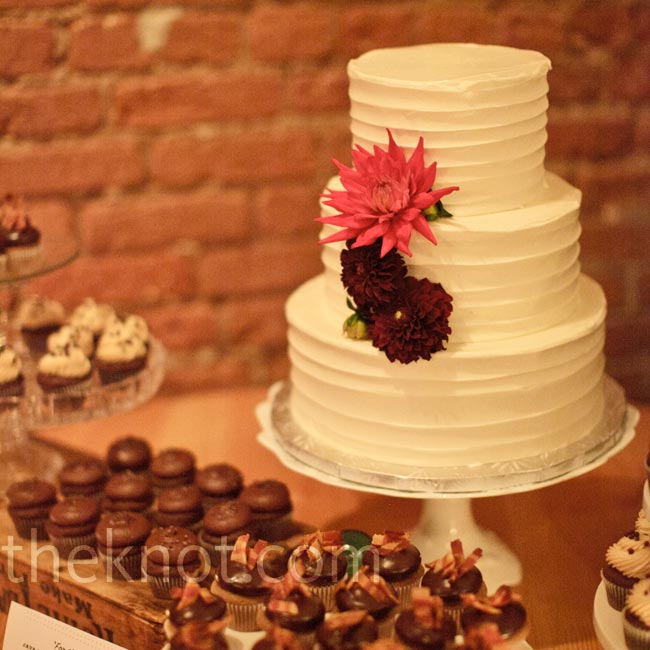 Although coasted in a simple knife-swirl frosting design, Jill and Mike's cake had layers of fun flavors like red velvet and Coca-Cola.