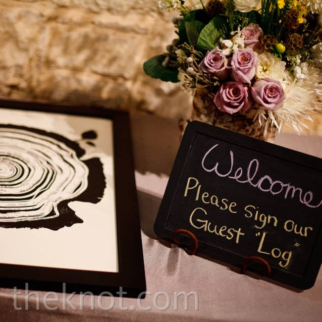 "To create a unique keepsake, the couple asked guests to sign inside one of the tree rings of a sign-in ""log"" poster."