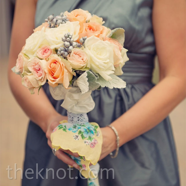 The bridesmaids carried their peach rose bouquets wrapped in handkerchiefs that had also been wedding invitations.