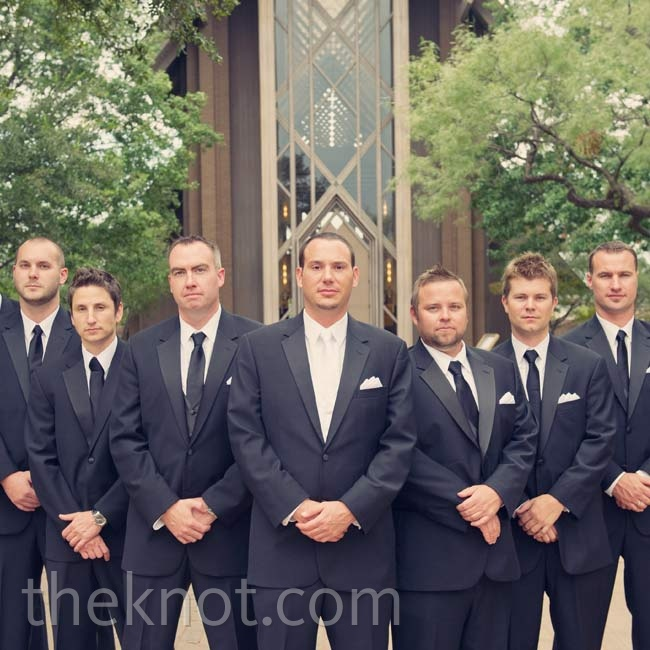 Bryan's white tie stood out among his groomsmen's simple black ones.