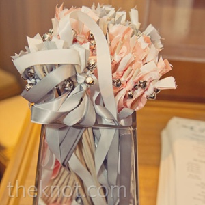 As Amelia and Bryan left the ceremony, guests waved these ribbon streamers.