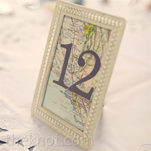 Each table was marked with a framed vintage map of a city that Amelia or Bryan had lived in.
