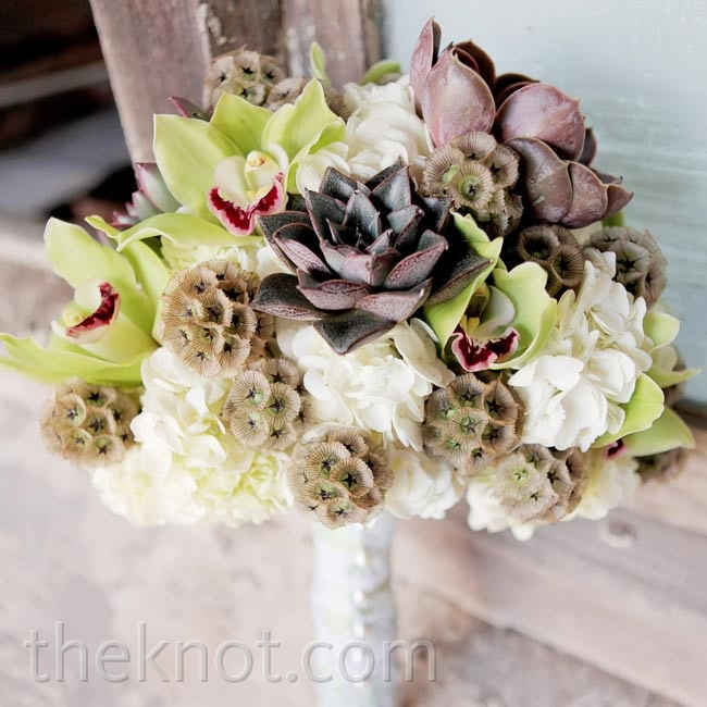"Fluffy round scabiosa pods (""Definitely something I'd never seen before,"" Batrease says) were a must for her modern bouquet."
