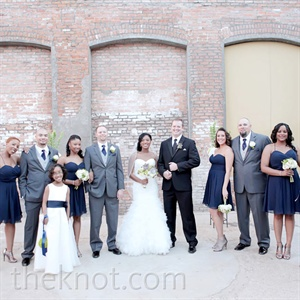 In gray suits and short navy dresses, the bridal party rocked a relaxed, semiformal style.