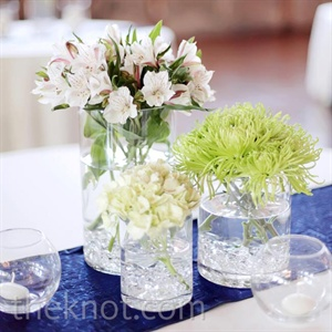 Cylinders of varying heights were filled with hydrangeas, spider mums and alstroemeria for that sleek look.