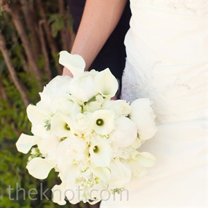 A round posy of white peonies, calla lilies, roses and lilacs made for a classic bridal bouquet.