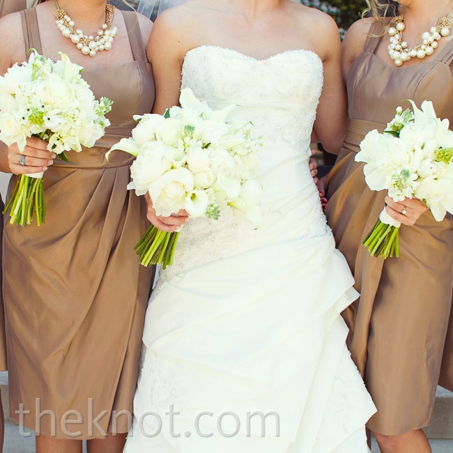 The Empire-waist dresses with sweetheart necklines flattered all six of Danielle's bridesmaids. Textured cream bouquets were a romantic touch.