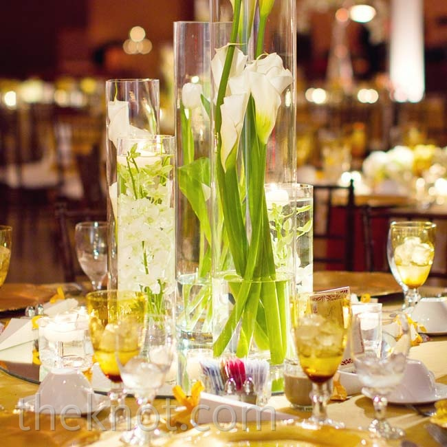 Lots of candles helped the white flowers (set in cylinder vases) take on a romantic glow.