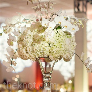 Tall bell vases topped with hydrangeas, roses and orchids gave some of the tables a boost in height.