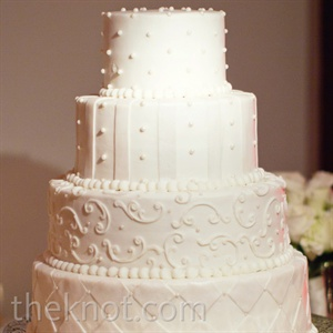 Different striped, checkered and swirled designs on each of the tiers gave the all-white cake a little character.