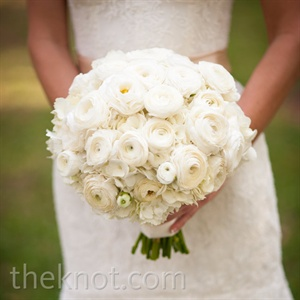 Kate carried a round, tightly bunched bouquet made of ranunculus, hydrangeas and other white flowers.