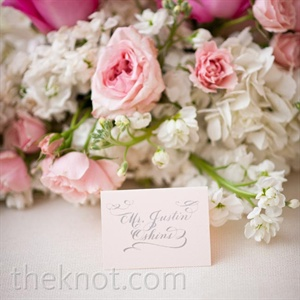 Both low and high centerpieces included pink roses, white stock, and hydrangeas.