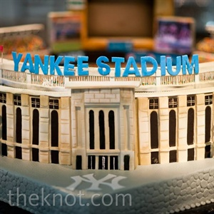 JJ's cake resembled Yankee Stadium in honor of his love of the team. An iPad playing a slideshow of photos of the couple was embedded in the cake.