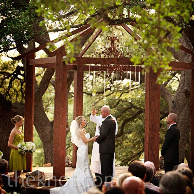 The couple exchanged vows beneath the property's open gazebo, which they decorated with hanging flowers in glass balls.