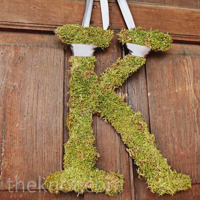 Hanging moss monograms incorporated the venue's rustic outdoor vibe.