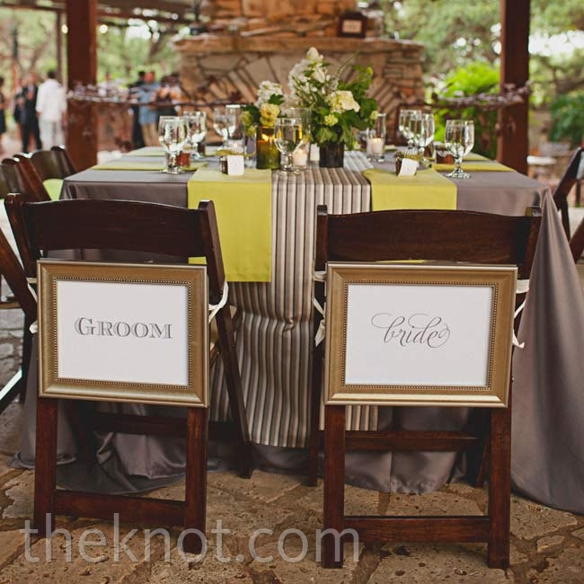 Framed signs distinguished Katie's and David's seats at the reception.