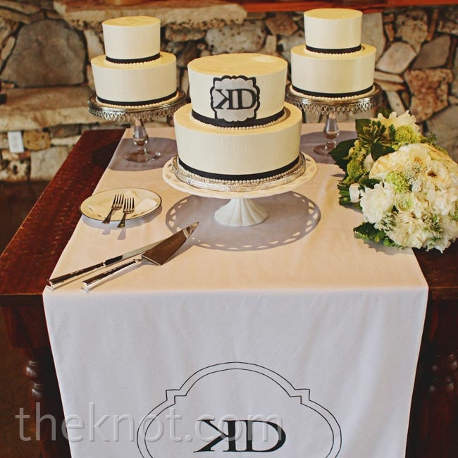 For a more casual look than one big cake, Katie and David served three small, simply decorated confections. One of them was marked with the couple's monogram.